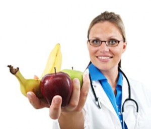 doctor holding fruits